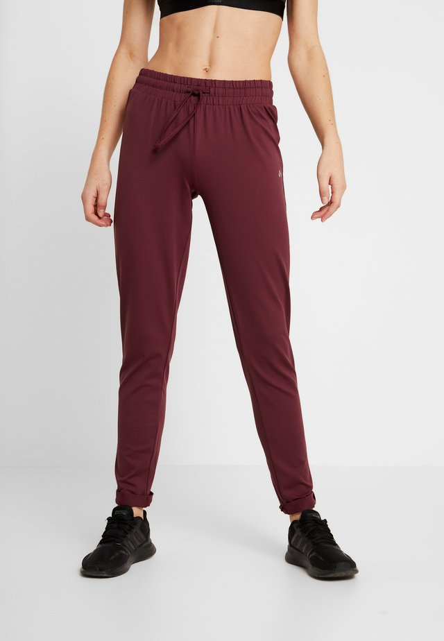 ONPJAVA LOOSE PANTS - Tracksuit bottoms - purple