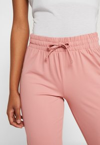 ONLY Play - ONPJAVA LOOSE PANTS - Tracksuit bottoms - dusty rose - 3