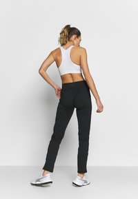 ONLY Play - ONPPERFORMANCE BAY SLIM PANTS - Tracksuit bottoms - black/red - 2