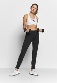 ONLY Play - ONPPERFORMANCE BAY SLIM PANTS - Tracksuit bottoms - black/red - 1