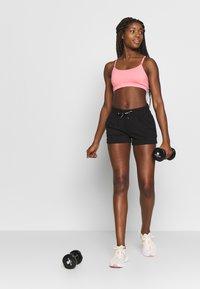 ONLY Play - ONPPERFORMANCE SHORTS - Sports shorts - black - 1