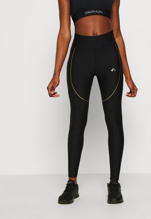 ONPJACINTE TRAINING - Leggings - black/white gold