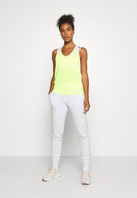 ONLY Play - ONPALYSSA PANTS - Joggebukse - white melange/saftey yellow - 1