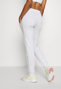 ONLY Play - ONPALYSSA PANTS - Joggebukse - white melange/saftey yellow - 3