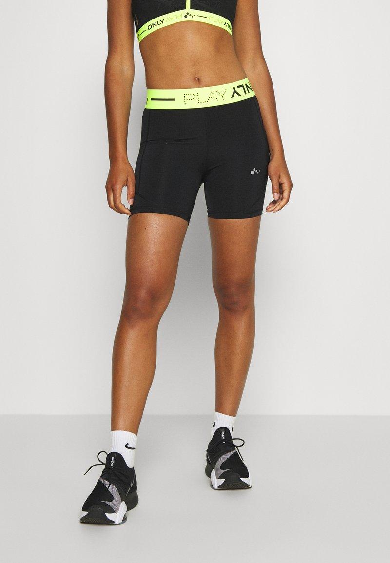ONLY Play - ONPALIX SHAPE UP TRAINING SHORTS - Leggings - black/safety yellow