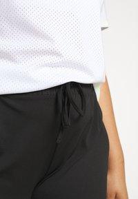 ONLY Play - ONPADOR PANTS CURVY - Teplákové kalhoty - black - 3