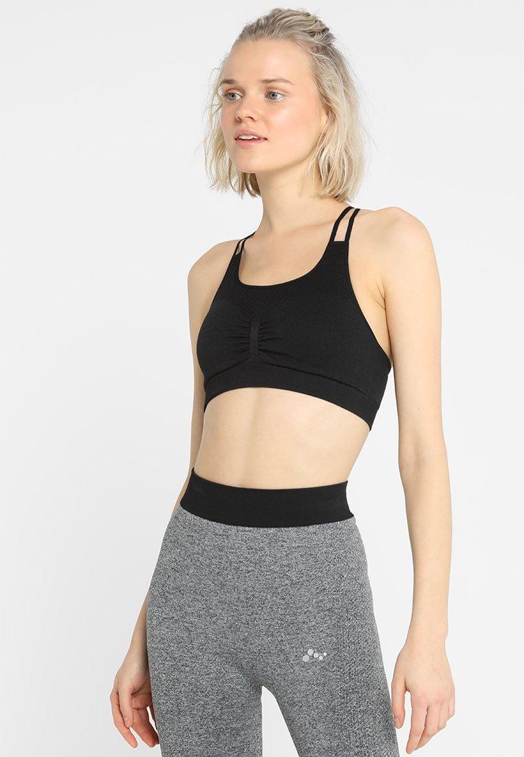 ONLY Play - ONPZAIDEE CIRCULAR BRA - Sports bra - black