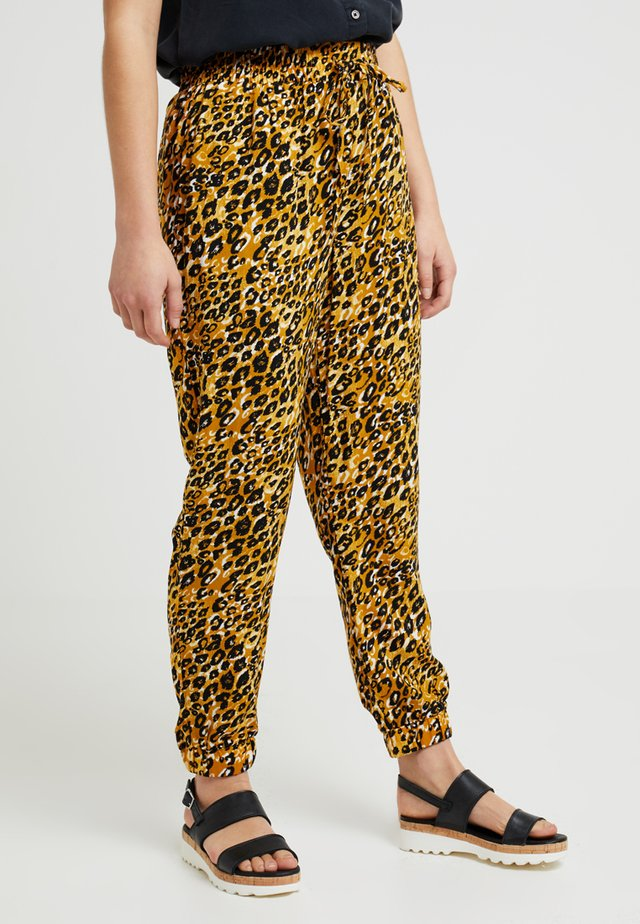 AMANDA ANIMAL - Trousers - yellow