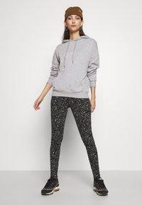 Noisy May - NMANILLA - Leggings - Trousers - black/white - 1
