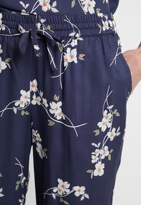 Noisy May - NMMAGIC VISCOSE PANTS  - Trousers - ombre blue/flowers - 4