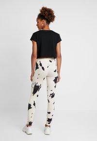 Noisy May - NMCOWE - Leggings - Trousers - ecru/black - 2
