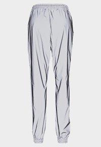 Noisy May - NMRANDY REFLEX PANT - Trousers - silver - 1
