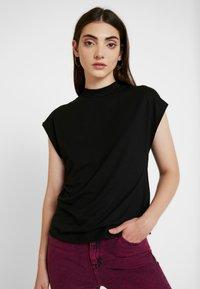 Noisy May - NMDENNY HIGH NECK - Camiseta básica - black - 0