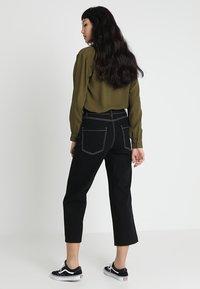 Noisy May - NMMARTIE CROP WIDE LEG - Jeans a zampa - black - 2
