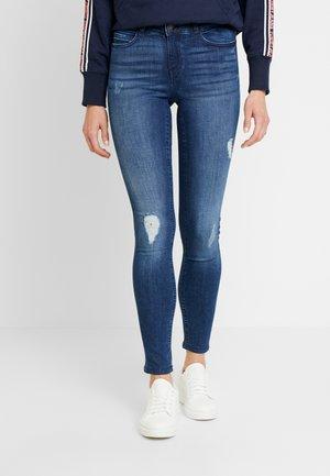 Skinny džíny - medium blue denim