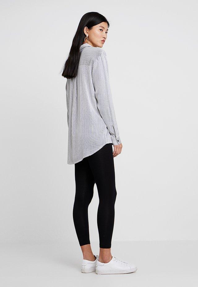 BASIC - Leggings - Trousers - black