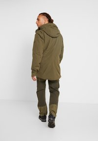 Norrøna - RØLDAL GORE TEX INSULATED - Outdoorjas - olive night - 2