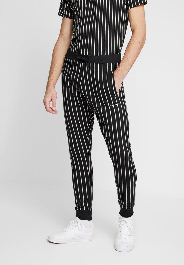 GHAZNI - Teplákové kalhoty - black