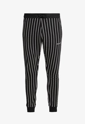 GHAZNI - Tracksuit bottoms - black