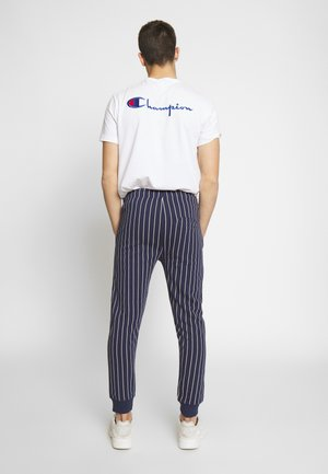 LEREDO - Tracksuit bottoms - navy