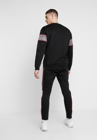 Nominal - CHURCH - Tracksuit bottoms - black - 2