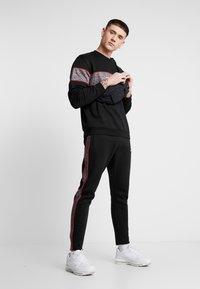 Nominal - CHURCH - Tracksuit bottoms - black - 1