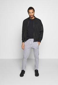 Nominal - ELISTA JOG - Pantalones deportivos - grey - 1