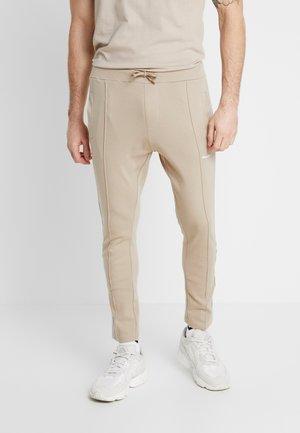 NORTAN - Pantalon de survêtement - sand