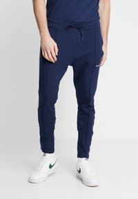 Nominal - NORTAN - Tracksuit bottoms - navy - 0
