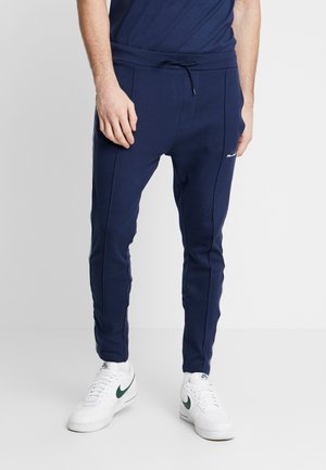 NORTAN - Tracksuit bottoms - navy