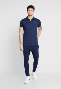 Nominal - NORTAN - Tracksuit bottoms - navy - 1