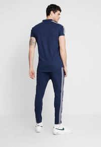 Nominal - NORTAN - Tracksuit bottoms - navy - 2