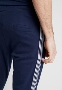 Nominal - NORTAN - Tracksuit bottoms - navy - 3