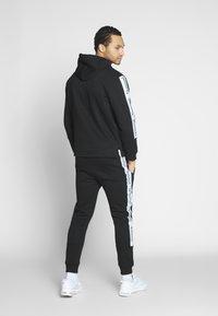 Nominal - KRIS - Pantalon de survêtement - black - 2