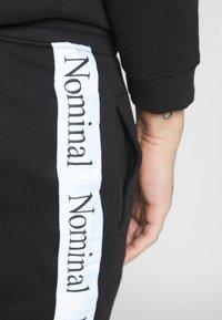 Nominal - KRIS - Pantalon de survêtement - black - 5