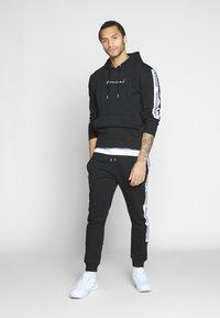 Nominal - KRIS - Pantalon de survêtement - black - 1
