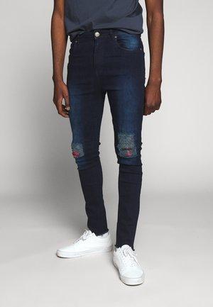 DOGO - Slim fit jeans - indigo blue