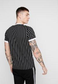 Nominal - SNOW - T-shirt med print - black - 2