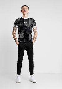 Nominal - SNOW - T-shirt med print - black - 1