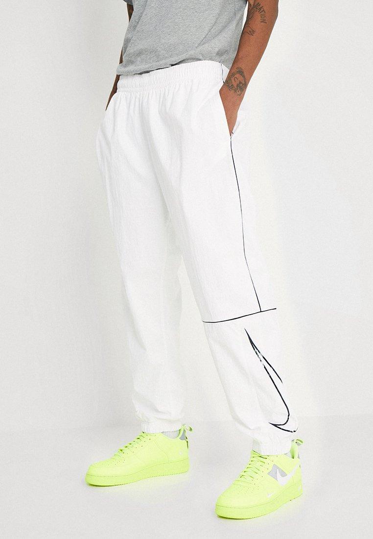 Nike SB - TRACK PANT - Jogginghose - white/black