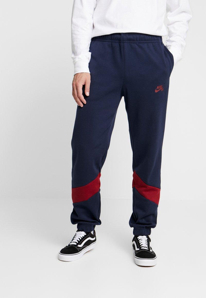Nike SB - DRY ICON TRACK PANT - Trainingsbroek - obsidian/summit white