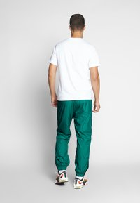 Nike SB - SHIELD - Verryttelyhousut - neptune green - 2