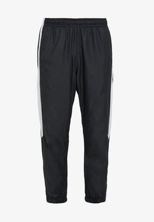 SHIELD - Tracksuit bottoms - black/white