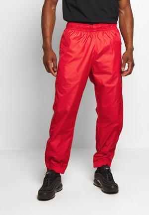 TRACK PANT - Teplákové kalhoty - university red/midnight navy