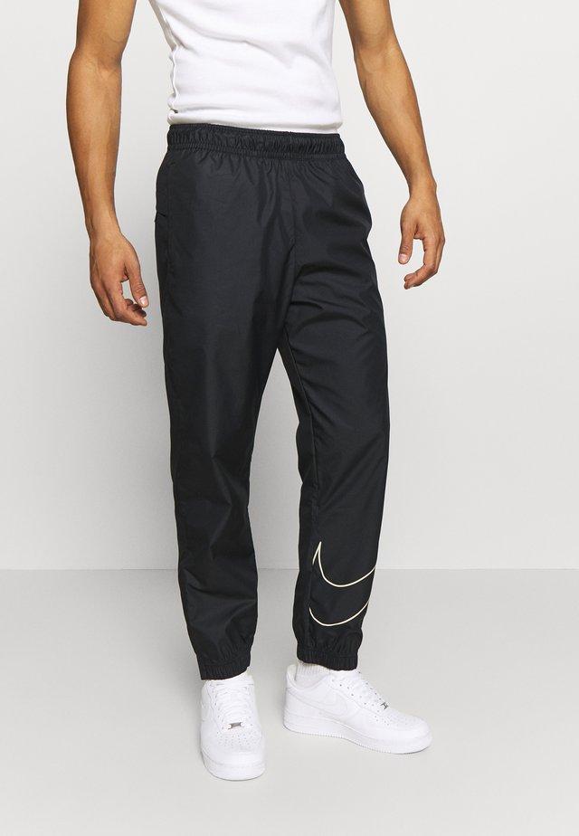 TRACK PANT - Pantalon de survêtement - black/fossil