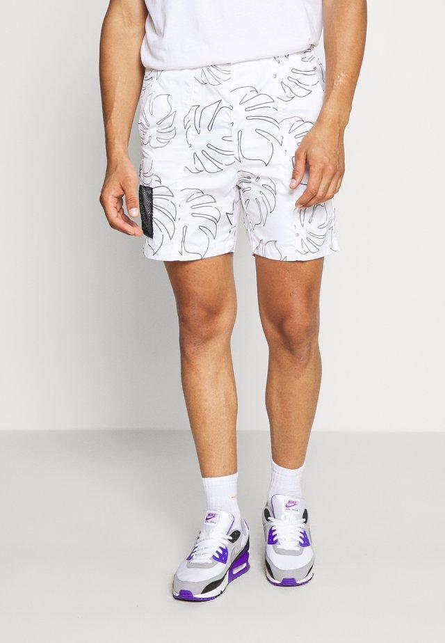 PARADISE WATER - Shorts - white/black