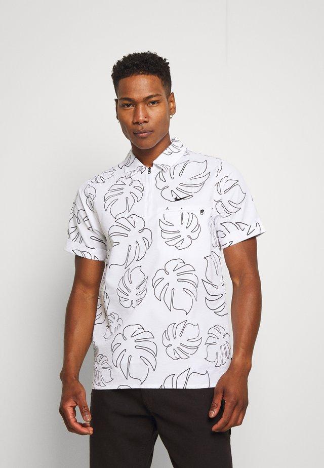 PARADISE - Polo shirt - white