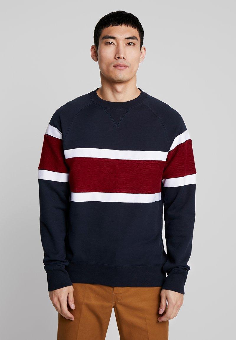 Nike SB - EVERETT - Sweatshirt - dark obsidian/team red/white