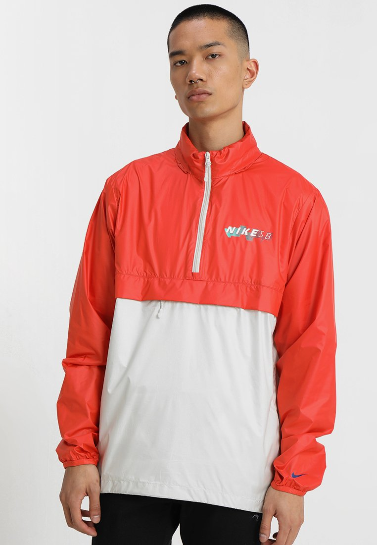 Nike SB - ANORAK PACK HOOD - Veste coupe-vent - vintage coral/light bone/hyper royal