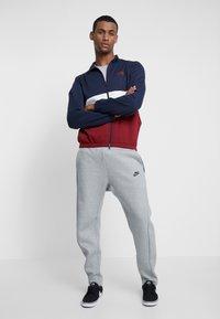 Nike SB - DRY JACKET TRACK - Training jacket - obsidian/team red/obsidian - 1